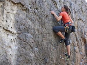 girl rock climbing outdoors